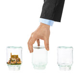House and shell game with glass jars Stock Photography