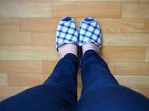 House shoes on feet step. Walking in the house Royalty Free Stock Photo