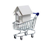 House and shopping cart. Stock Image
