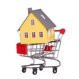 House in shopping cart isolated. Mortgage Royalty Free Stock Photos