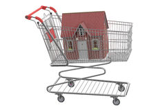 House in shopping cart. Isolated on white background Royalty Free Stock Images