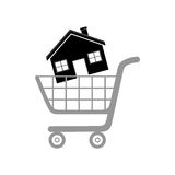 House in shopping cart on a white background Royalty Free Stock Photo