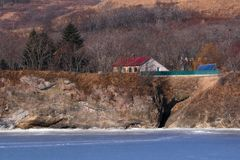 House on the shore of the frozen sea Royalty Free Stock Image