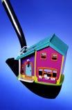 House on shovel Royalty Free Stock Photos