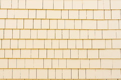 House siding. Painted cedar shingles / shakes for house siding royalty free stock photography