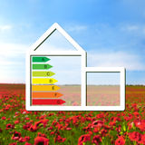 House with the sign of energy saving on a background field with Stock Images