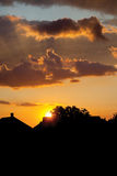 House silhouette with gorgeous sunset sky background. House roofs at sunset with beautiful sky Stock Image