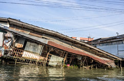 House sinking in Water after Tsunami. Frontal dramatic view of a wooden house sinking in water after Tsunami Stock Photo
