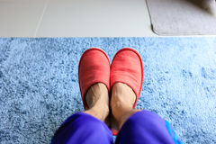 House slipper shoe in living room with blue carpet Royalty Free Stock Photos
