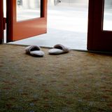 House slippers. Standng by door Stock Photography