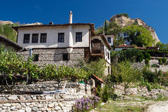 House on a slope of chalk rocks Royalty Free Stock Images