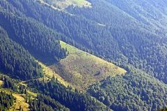 House on the slope of mountains and forests Royalty Free Stock Image