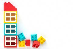 Lego bricks. House of Small and big plastic constructor bricks on white background. Popular toys. Free space for text. Colorful House of Small and big plastic royalty free stock images