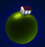 House on a small green planet Stock Photo