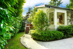 House with small walkout deck and concrete walkway Stock Images