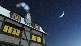 House with smoking chimney at snowfall night Stock Photography
