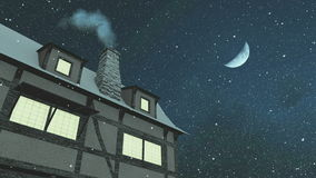House with smoking chimney at snowfall night