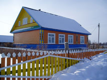 House in a snow. The rural house in a snow, winter, Russia Stock Images