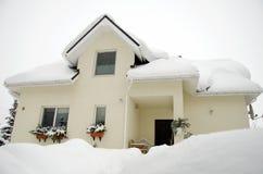 House with snow Stock Photos