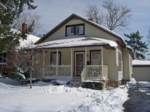 House in the Snow. Charming single family bungalow style home in the snow Stock Image