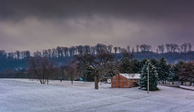 House and snow covered field in rural York County, Pennsylvania. Royalty Free Stock Photo