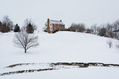 House on a snow covered hill, in a rural area of Carroll County, Stock Image
