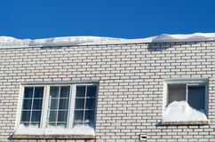 House with snow on roof and window Royalty Free Stock Images