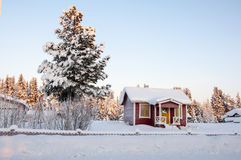 House in the snow Stock Images