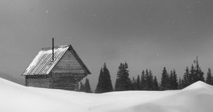 House and snow storm in the mountains stock video footage