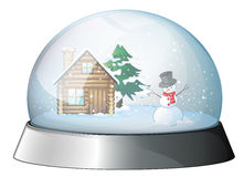 A house and a snowman inside the crystal ball Royalty Free Stock Photography