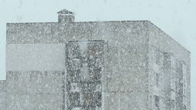 House in the snowstorm. Real time footage stock video footage