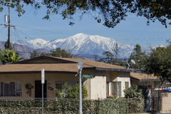 House with snowy Mt. Baldy behind stock images