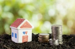 House in soil, saving money to build a house concept stock image