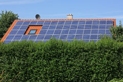 House with solar moduls with a hedge Royalty Free Stock Image