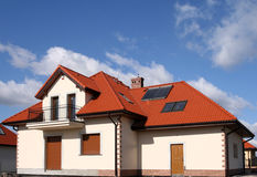 House with solar panels. Beautiful new home with solar panels on the roof - environmental friendly Stock Photography