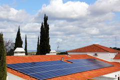 House with solar panels on roof Royalty Free Stock Images