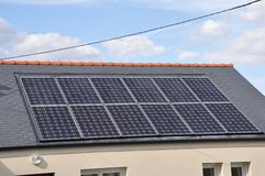 House with solar panels on roof royalty free stock photos