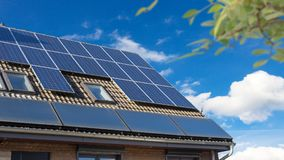House with solar panels on the roof. Against blue sky Stock Images