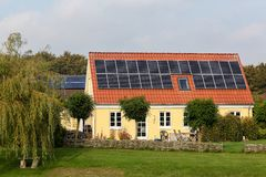 House with solar panels on the roof. In Denmark royalty free stock images