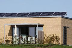 House with solar panels on the roof Stock Photography