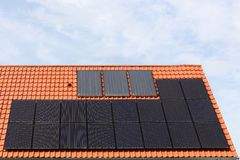 House with solar panels on a roof. In Denmark Stock Image