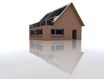 House with solar pannels in floor reflection Royalty Free Stock Photography