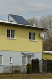 House with solar water heater. Panel on the roof Royalty Free Stock Photography