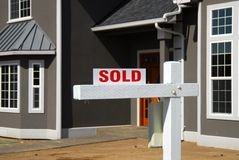 House sold 2. Sold sign in front of new house Royalty Free Stock Photos
