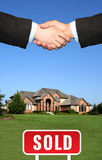 House sold. House, sign sold and shakehand royalty free stock photos
