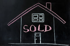 House sold. Chalk conceptional drawing - House sold stock images