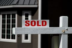 House sold. Sold sign in front of new house Royalty Free Stock Image