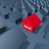 House is Sold. One red house with SOLD sign royalty free stock photography