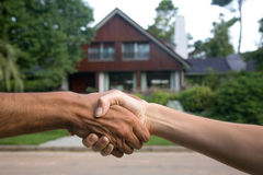 House sold. Holding hands to close deal royalty free stock photo