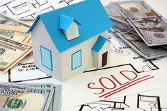 House sold. Model  house and construction plan with the word sold Stock Photo